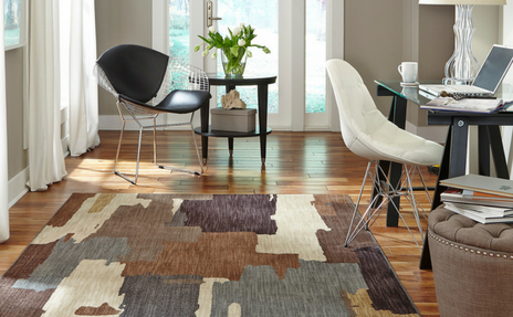 Mocha and ivory abstract patterned Karastan area rug