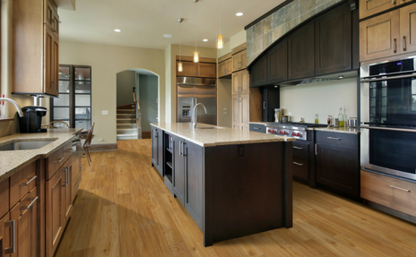 luxury vinyl replicating hardwood flooring in kitchen